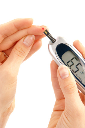 Dependent first type Diabetic patient measuring glucose level blood test using ultra mini glucometer and small drop of blood from finger and test strips isolated on a white background